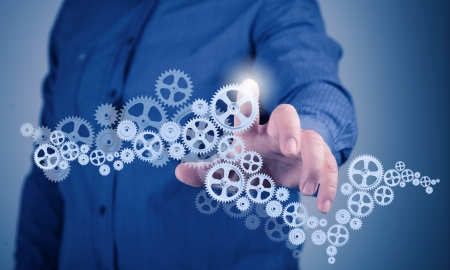 Image of businessman touching gear elements  Mechanism concept