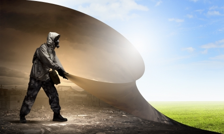 Image of man in gas mask turning page  Ecology concept Stock Photo - 21439678