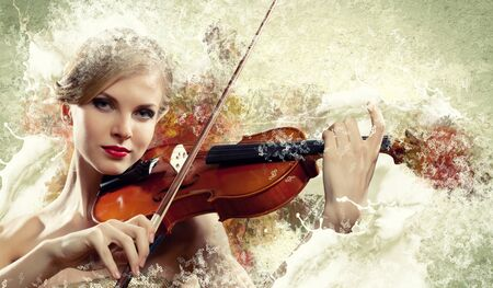 Image of beautiful female violinist playing with against colorful background photo