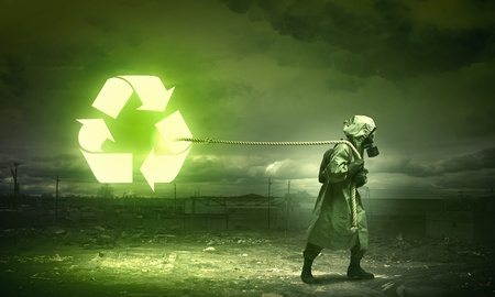 Man in respirator against nuclear background  Recycle concept photo
