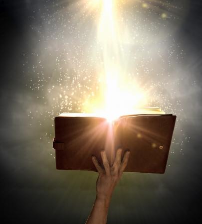 black worship: Close up of human hand holding saint book