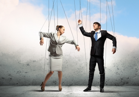 Image of businesspeople hanging on strings like marionettes  Conceptual photography Imagens