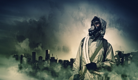 gaseous: Man in gas mask against disaster background  Pollution concept Stock Photo
