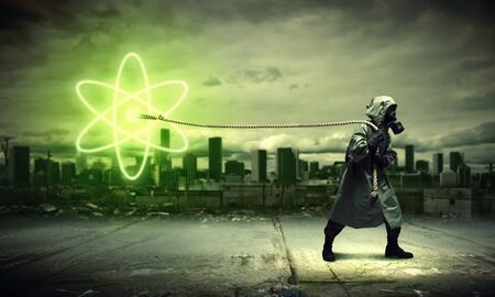 Man in respirator against nuclear background  Radioactivity concept Stock Photo - 21421105