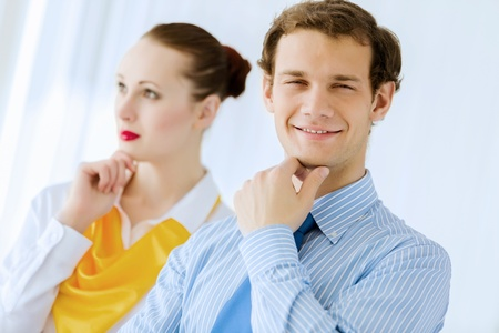 joyfully: Image of businessman and businesswoman smiling joyfully Stock Photo