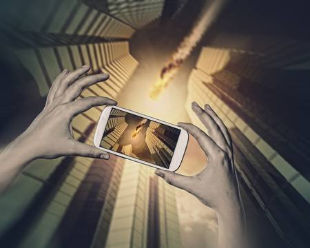 Close up of human hands taking photo of falling meteorite Stock Photo - 21480789