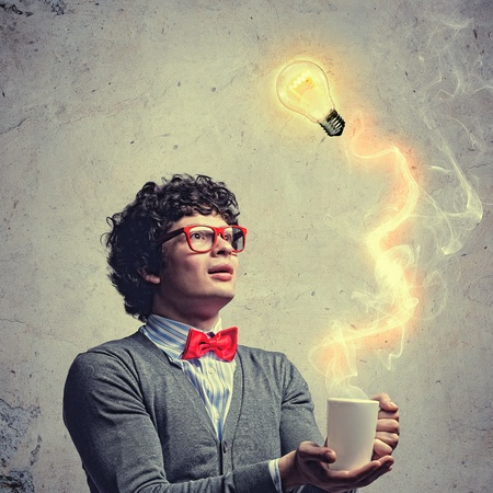 experimenting: Young man with smoke coming out of a cup and a bulb experimenting