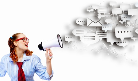 communicate: Funny looking woman speaking with a megaphone Stock Photo