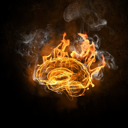 the thinker: Human brain in fire flames against black background