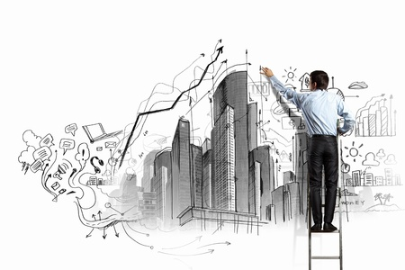 Back view of businessman drawing sketch on wall Stock Photo - 21498502