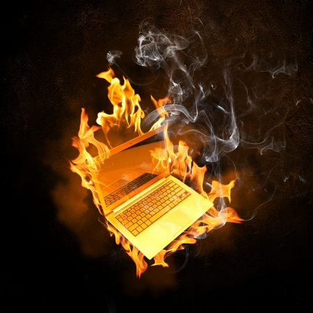 fire damage: Illustration of burning laptop in fire flames