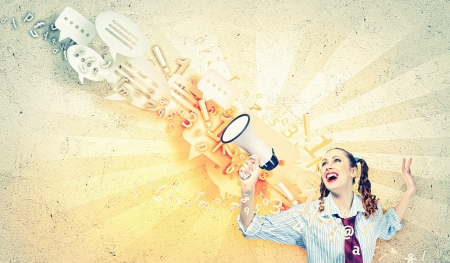 voice: Funny looking woman speaking with a megaphone Stock Photo