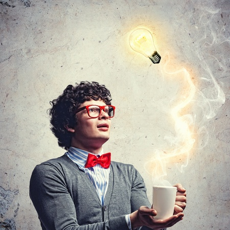 obsessed: Young man with smoke coming out of a cup and a bulb experimenting