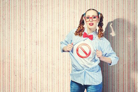braveness: Young woman acting like hero with sign on chest Stock Photo