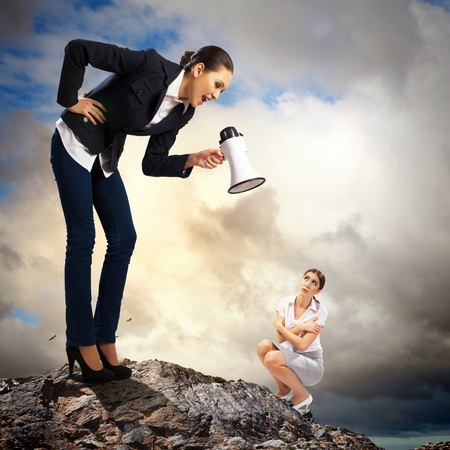 female boss: Angry businesswoman with megaphone shouting at colleague