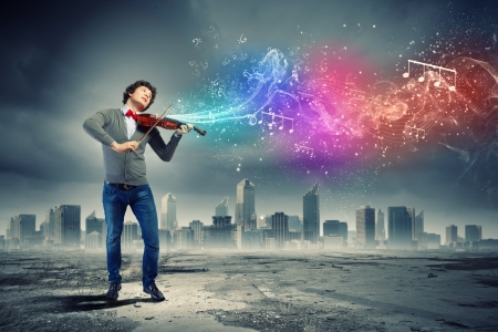 fiddlestick: Image of young handsome man playing violin Stock Photo