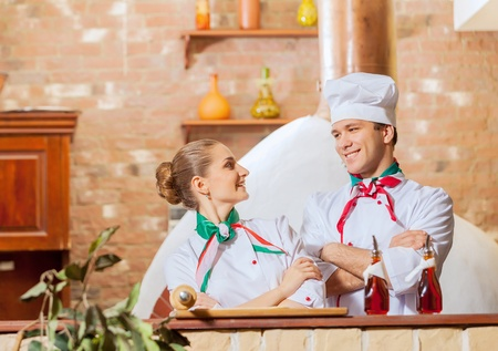 catering service: Portrait of two cooks with crossed arms looking at the camera Stock Photo
