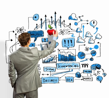 Back view image of businessman drawing sketches on wall Stock Photo - 21482148