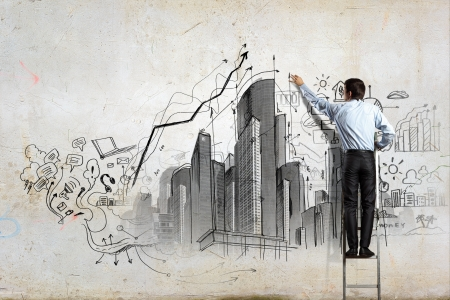 Back view of businessman drawing sketch on wall Stock Photo - 21482174