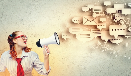 Funny looking woman speaking with a megaphone photo