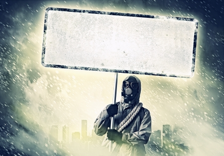 Stalker in gas mask with blank banner  Disaster concept Stock Photo - 21495132
