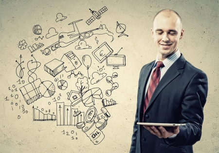 Image of businessman holding tablet Collage drawings photo