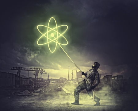 radioactivity: Man in respirator against nuclear background  Radioactivity concept