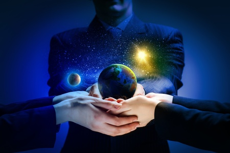 carefully: Close up image of human hands holding earth planer  Ecology concept