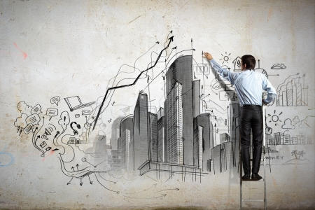 Back view of businessman drawing sketch on wall photo
