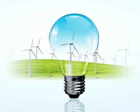 eficiencia energetica: Bombilla el�ctrica y molinos de viento generadores de concepto de energ�a renovable Foto de archivo