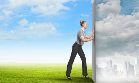 virtual world: Image of attractive business woman changing reality Stock Photo