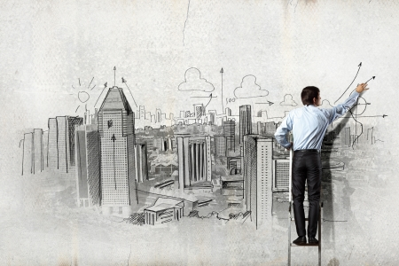 Back view of businessman drawing sketch on wall Stock Photo - 21521068