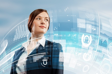 advanced technology: Image of attractive businesswoman against hightech background