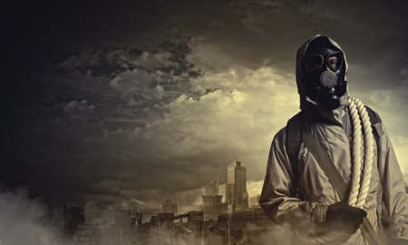 biochemical: Man in gas mask against disaster background  Pollution concept Stock Photo