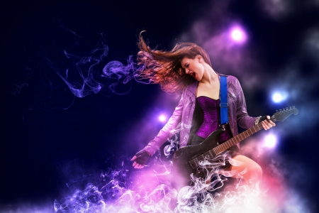 heavy metal music: Young attractive rock girl playing the electric guitar Stock Photo