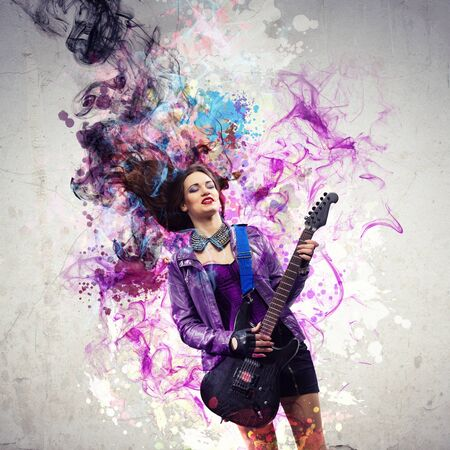 Rock passionate girl with black wings and lights photo