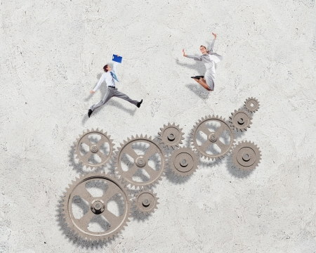 Businessman and businesswoman with cog wheel elements  Organization concept Stock Photo - 21580916