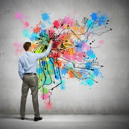 creative thinking: Back view of businessman drawing colorful business ideas on wall Stock Photo