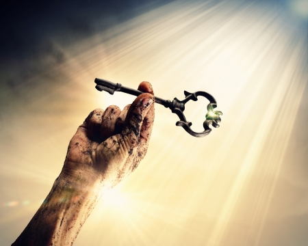 Key in human hand  Struggle and success photo