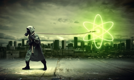 Man in respirator against nuclear background  Radioactivity concept Stock Photo - 21680456