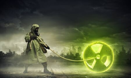 Man in respirator against nuclear background  Radioactivity concept Stock Photo - 21680624