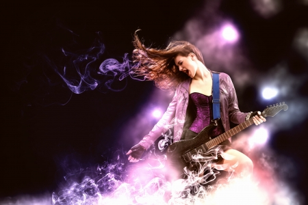 Young attractive rock girl playing the electric guitar 스톡 콘텐츠