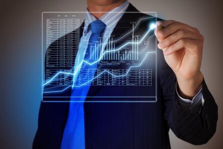 sales report: Closeup image of businessman drawing 3d graphics