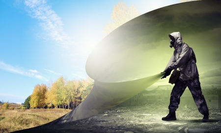 Image of man in gas mask turning page  Ecology concept Stock Photo - 21681083