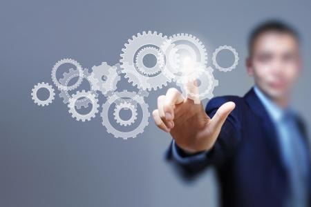 Afbeelding van zakenman wat betreft gear elementen Mechanisme begrip Stockfoto