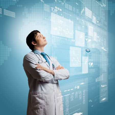 Young concentrated male doctor with arms crossed against digital background