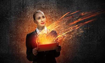 futuristic woman: Image of young business woman holding ipad