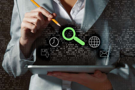 Image of businesswoman holding pen and tablet pc photo