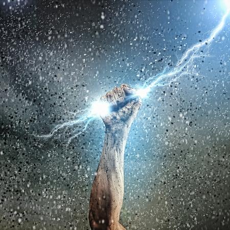clenching: Close-up of human hand clenching lightning flash