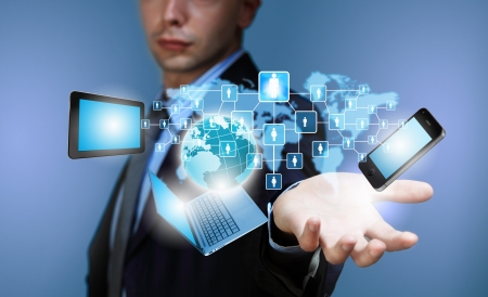Image of business person holding devices in hands photo